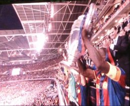 Éric Abidal lifting the trophy