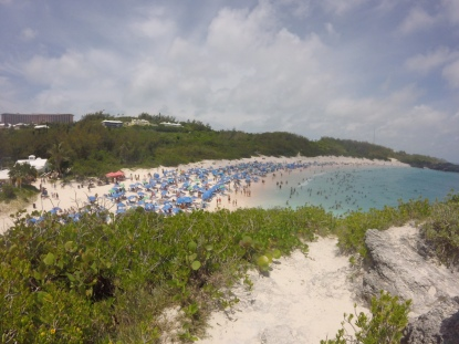 The view of the crowded beach from the big rock